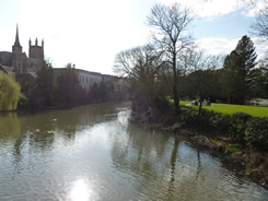View from suspension bridge looking down the river Leam. St Marys church on left hand side, with Jephson Gardens to the right.